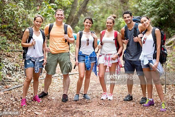 Group of backpackers having fun hiking