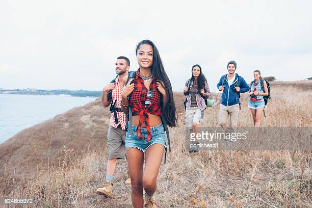 Group of backpackers hiking together