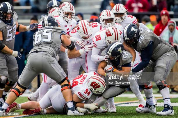 A group of Badger defenders Wisconsin Badger defensive end Conor Sheehy Wisconsin Badger outside linebacker Tyler Johnson Wisconsin Badger defensive...