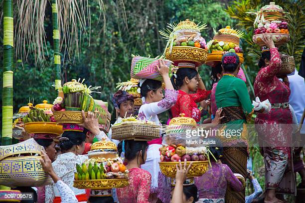 Group of Balinese women before the entering to the temple with an offerings to the gods. Full Moon Ceremony in Bali Indonesia.