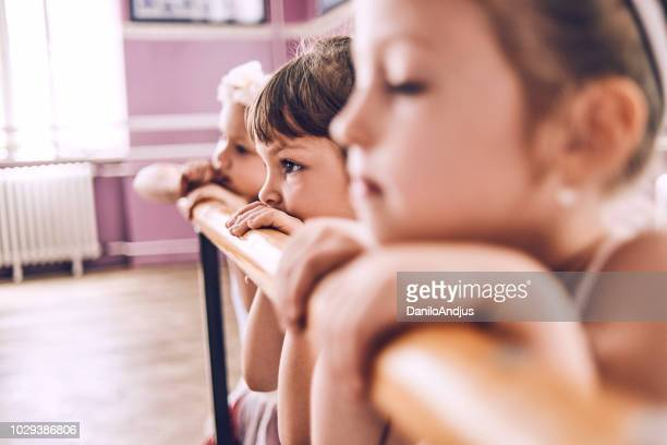 group of ballerinas relaxing after ballet class - sports round stock pictures, royalty-free photos & images