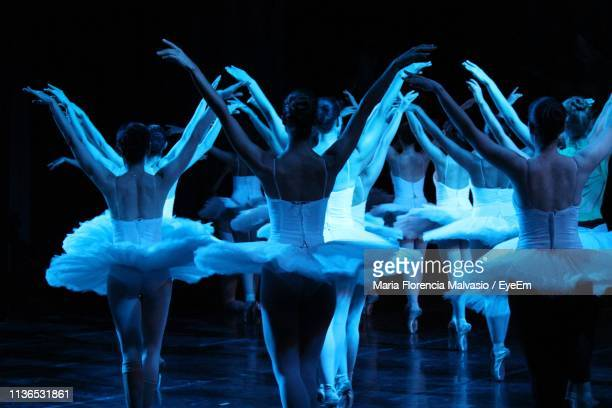 group of ballet dancers dancing on floor - performing arts event stock pictures, royalty-free photos & images