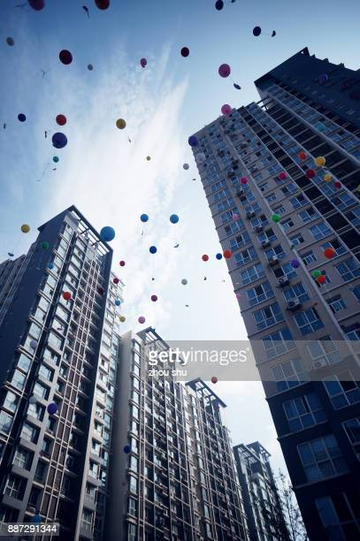 A group of balloons flying in the air