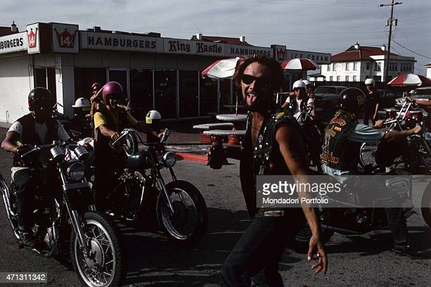 A group of Bandidos American bikers photographed in a fast food yare one of them is doing tongue out to the photographer Texas September 1969