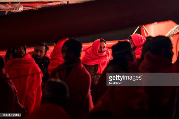 A group of Bangladesh migrants onbaord the vessel waiting to be transferred to the Red Cross Care unit at the Malaga harbour Malaga