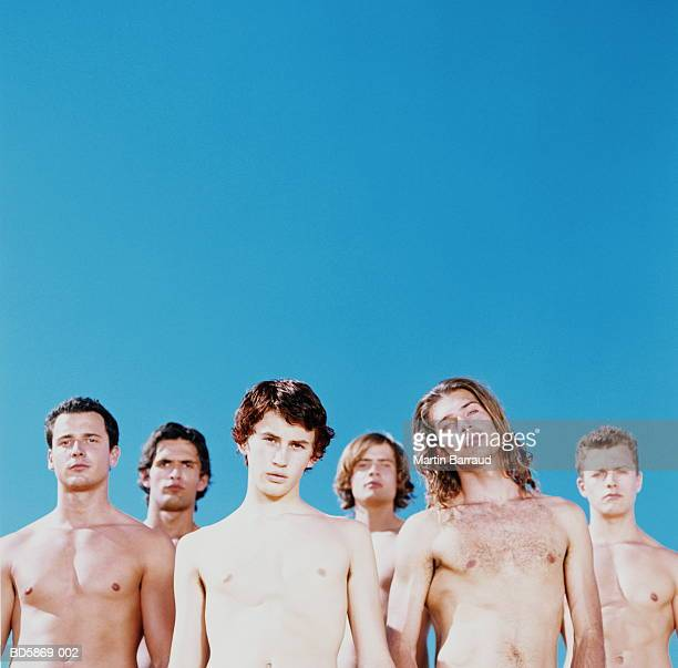 Group of bare-chested young men, portrait