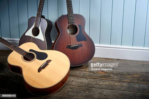 A group of baritone electroacoustic guitars including a Taylor 326E Alvarez Artist Series ABT60E Baritone and a Vintage Gemini Paul Brett Baritone...
