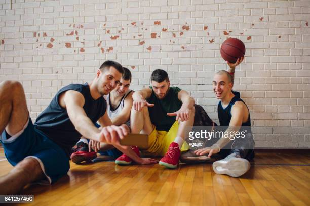 Group of basketball players making selfie