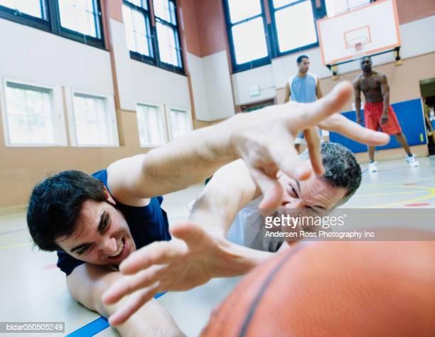 Group of basketball players playing basketball