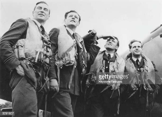 Group of Battle of Britain RAF pilots watch the skies as compatriots take off for the benefit of television cameras at Biggin Hill.
