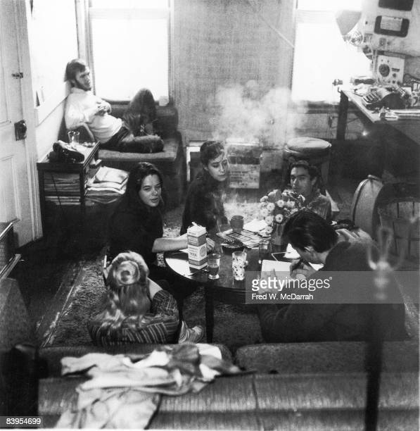 A group of beatniks sit in an apartment New York New York December 5 1959 Pictured foreground from left Dian Doyle and Kirby Doyle far side of table...