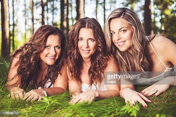 Group of beautiful women in green nature