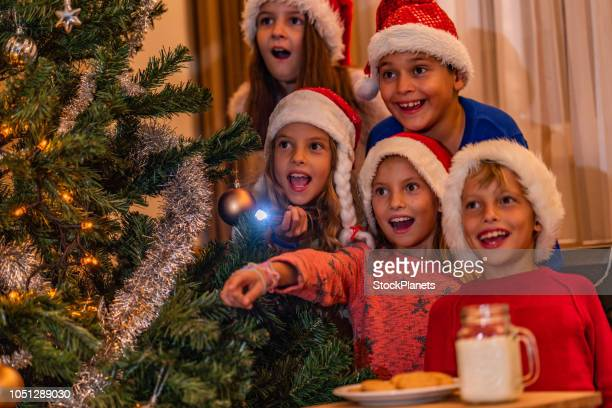 group of beauty kids waiting a santa claus - naughty santa stock photos and pictures