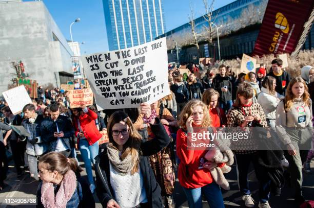 A group of Belgian students are holding placards and shouting slogans during the demonstration for better climate policy in Brussels on February 14th...
