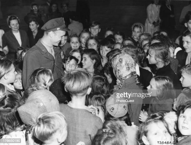 A group of Berlin children try to express their appreciation to Lieutenant Gail Halvorsen the originator of Operation Little Vittles for the...