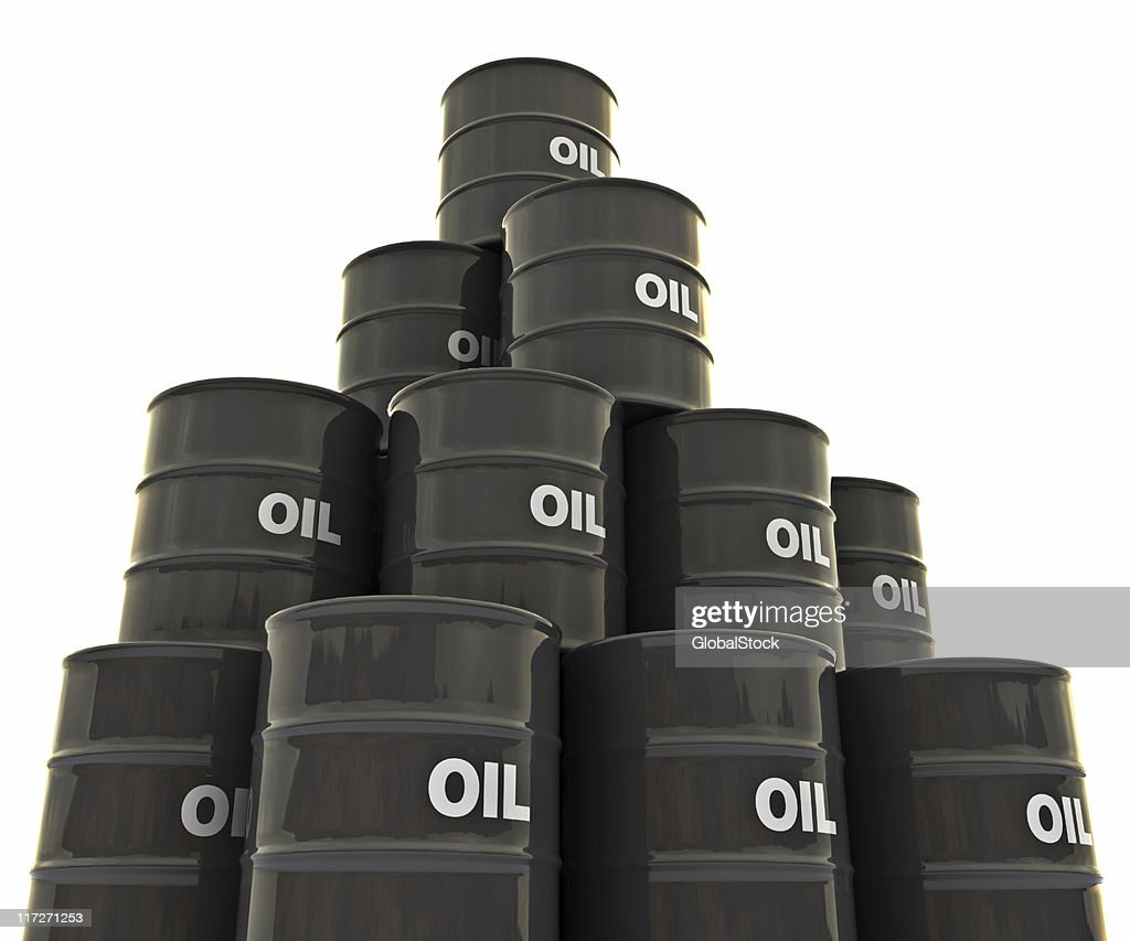 Group of black oil drums stacked up : Stock Photo