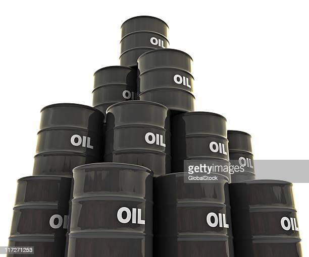 group of black oil drums stacked up - drum container stock photos and pictures