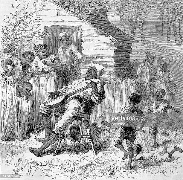 A group of black slaves in Virginia listen to a man sing to the accompaniment of his banjo This engraving captioned In ole Virginny accompanied the...