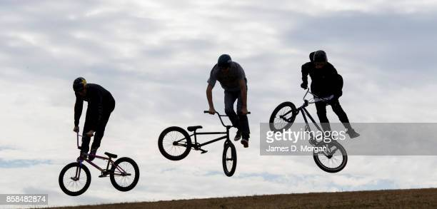 A group of BMX bicycle freestyle athletes jump on October 7 2017 in Sydney Australia The Big Adventure at Sydney Park is part of the monthlong Sydney...