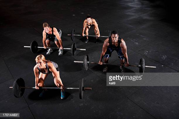 Group of body builders lifting barbells