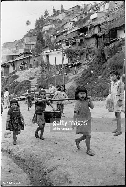 A group of Bogota's young shantytown children laboring and carrying water to their homes They will receive a visit by Pope Paul VI