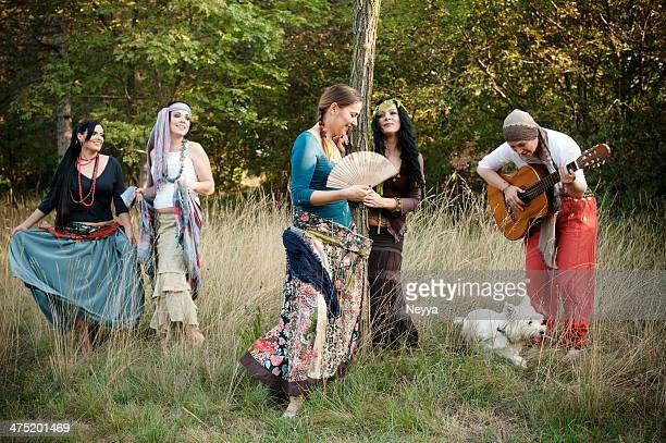 group of bohemian gypsy women - gypsy stock pictures, royalty-free photos & images