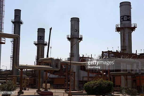 A group of boiler towers stand at the Petroleos Mexicanos Miguel Hidalgo Refinery in Tula de Allende Mexico on Thursday March 6 2014 The Pemex board...