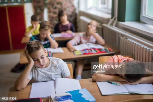 Group of bored elementary students in the classroom.