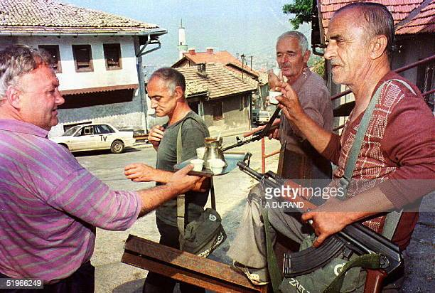Group of Bosnian men drink coffee 09 Aug 1992 in Sarajevo, Bosnia-Hercegovina, as the Bosnian capital remained mostly quiet 08 and 09, but fighting...