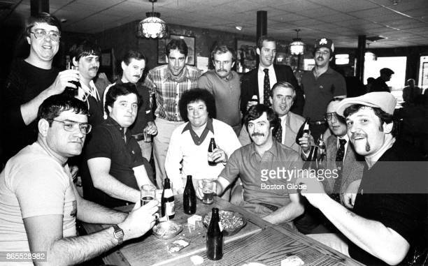 A group of Boston Police Department recruits celebrate at the Bell In Hand Tavern on Apr 15 1980 after Boston Mayor Kevin White reauthorized their...