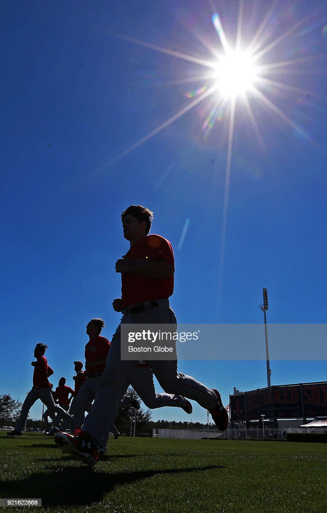 A group of Boston Red Sox pitchers get in some end of workout sprints under bright sunshine and clear blue skies during spring training at the Player Development Complex at Jet Blue Park in Fort Myers, FL on Feb. 17, 2018.