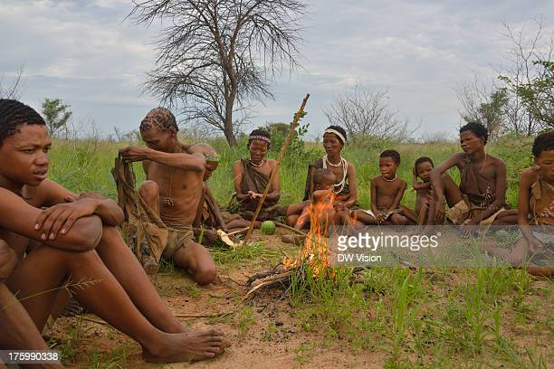 CONTENT] A group of Botswana San 'bushmen' sitting around the fire they just created The San are a traditional hunter/gathering people in southern...