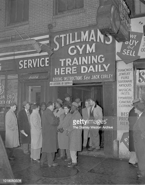 A group of boxers and fans gathering outside of Stillman's Gym circa 1955 in New York City New York