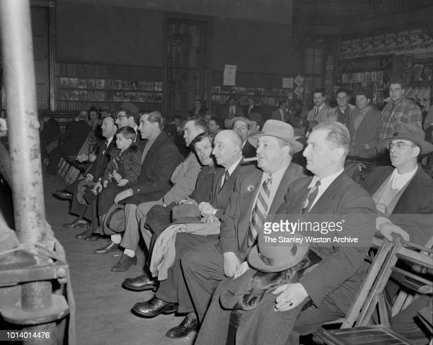 A group of boxing fans await a sparring match in Stillman's Gym circa 1955 in New York City New York