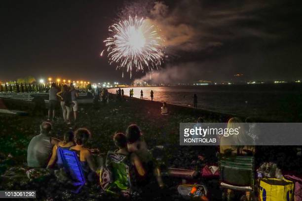 SCHIAVONEA CORIGLIANO CALABRIA ITALY A group of boys and girls watch the fireworks by the sea during the summer party for Santa Maria Ad Nives held...