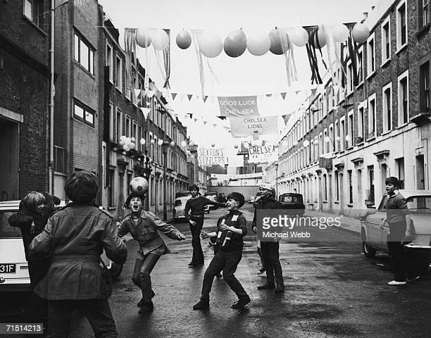 A group of boys celebrate the upcoming FA Cup Final between Leeds United and Chelsea at Wembley with a match of their own in Chelsea's Slaidburn...