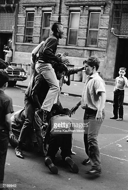 A group of boys climb on top one another on a New York City street New York circa 1970