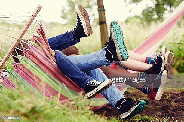 Group of boys having fun on a hammock