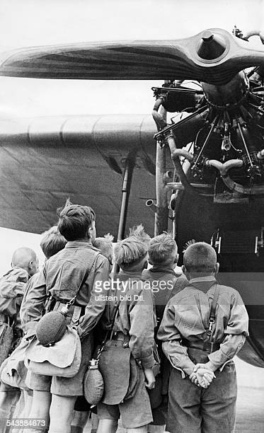 A group of boys in front of the propeller 1933 Photographer Weltrundschau Dr Franz Published by Das Neueste von der Mode 111933 Vintage property of...