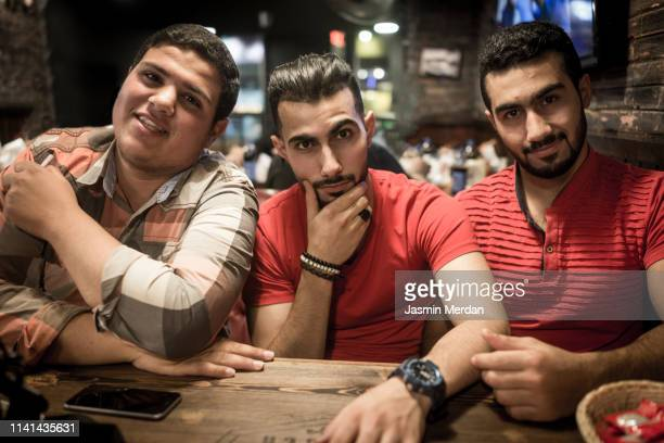 group of boys in restaurant - jordanian workforce stock pictures, royalty-free photos & images