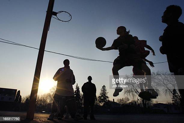 REODICA 03/29/06 TORONTO A group of boys Jeffrey Reodica's cousin shoot some afterschool hoops behind St Rose of Lima Catholic School Reodica was...