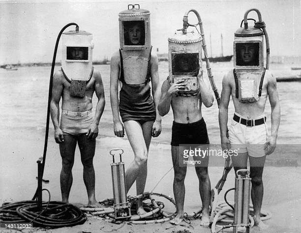 A group of boys made diving helmets from sections of hot water heaters boilers and other easily secured junk Los Angeles USA Photograph June 23 1933