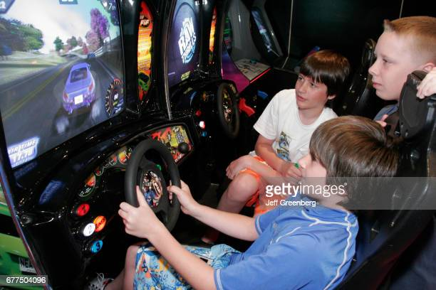 A group of boys on a simulated driving game on the mms Noordam