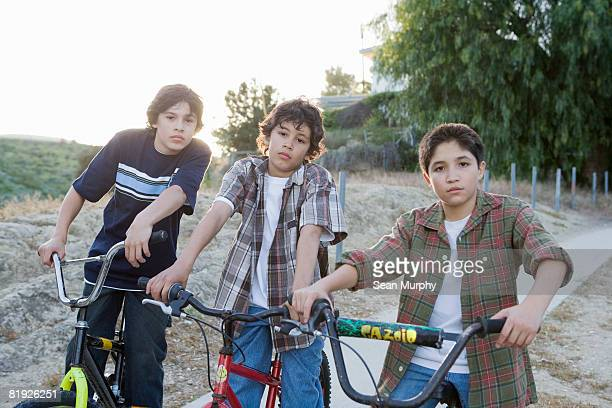 group of boys on bicycles