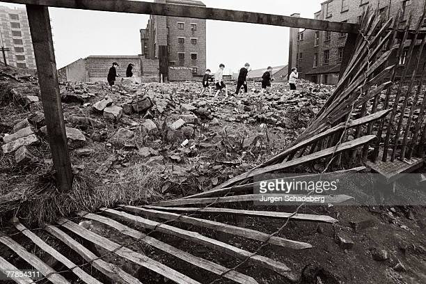 A group of boys pick their way through a wasteland in the Gorbals area of Glasgow 1968