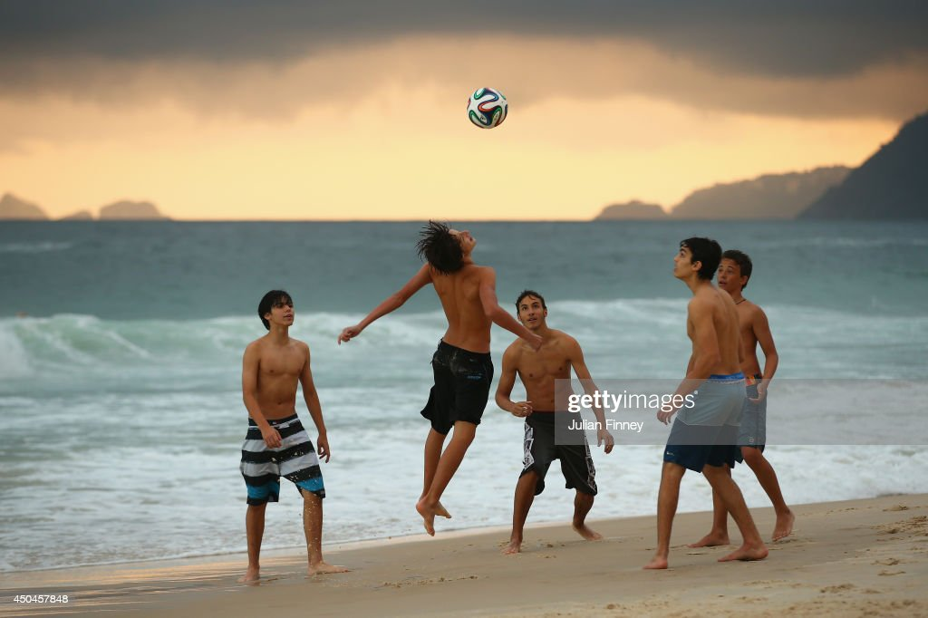 A group of boys play football on Ipanema beach on June 11, 2014 in Rio de Janeiro, Brazil.