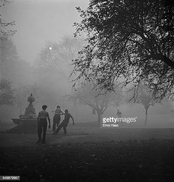A group of boys playing with a ball in a Central London park circa 1953