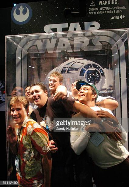 A group of boys pose while inside a large scaled replica action figure box during the ComicCon Convention July 24 2004 in San Diego California...
