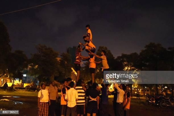 A group of boys practice for Dahi Handi on Thursday night at Juinagar Garden on August 11 2017 in Mumbai India Dahi Handi is one of the festive...