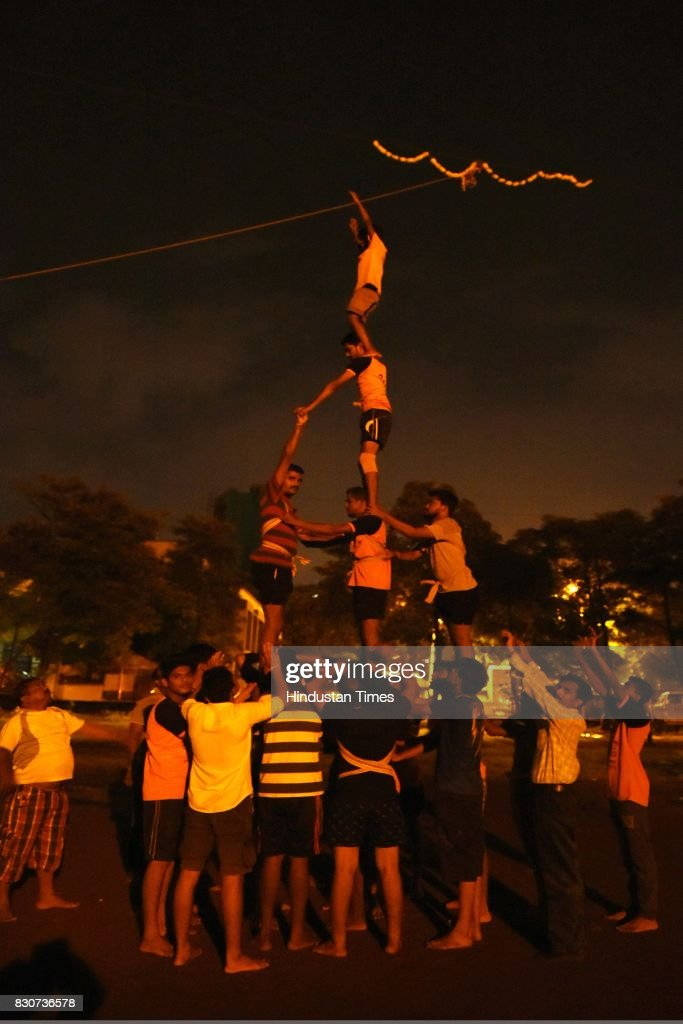 A group of boys practice for Dahi Handi on Thursday night at Juinagar Garden, on August 11, 2017 in Mumbai, India. Dahi Handi is one of the festive events and a team sport during the Hindu festival Gokulashtami, which is known as Krishna Janmashtami in the rest of the country, and celebrates the birth of Krishna.
